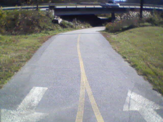 Heading towards where path goes beneath the busy HWY. 64/Four Seasons BLVD/MLK Blvd overpass.