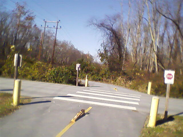 Greenway path crosses the entrance road to Jackson Park here.